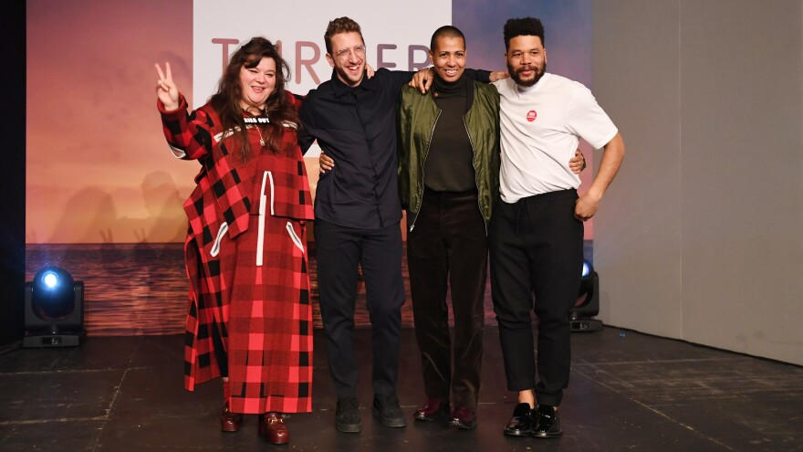 Tai Shani, Lawrence Abu Hamdan, Helen Cammock and Oscar Murillo pose for photographs after their names were announced as joint winners of the 2019 Turner Prize.