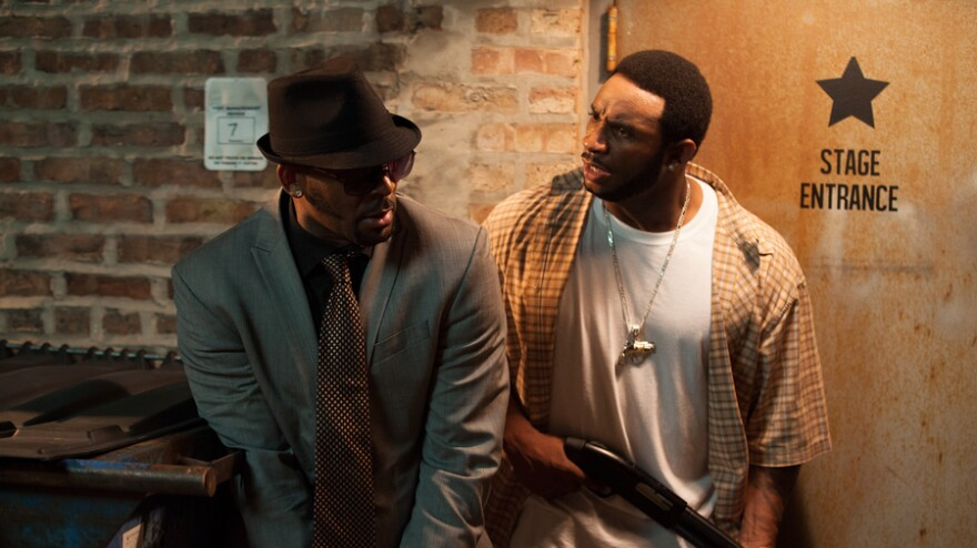 R. Kelly (left) as Sylvester, and Eric Lane as Twan, in <em>Trapped in the Closet</em>, which relaunched with new chapters last week on IFC.