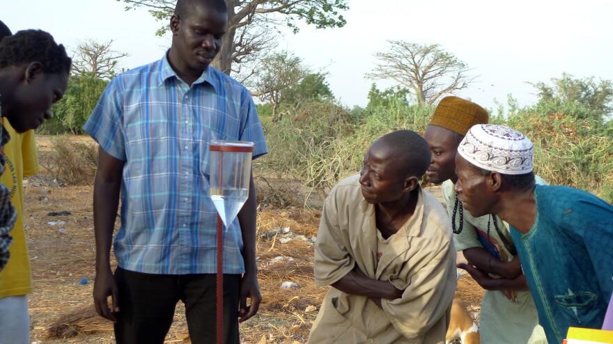 Farmers participate in a CGIAR climate training workshop on how to interpret seasonal rainfall forecasts in Kaffrine, Senegal.
