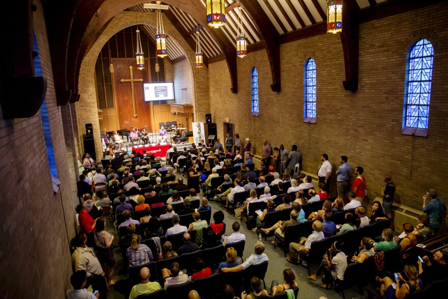 The conversation drew about 200 people to Wellspring Church. Over the course of two hours, many members of the audience shared similar reactions to problems in Ferguson.