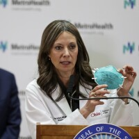 Ohio Department of Health Director Amy Acton holds up a mask as she gives an update about the state's response to coronavirus, on Feb. 27, 2020 in Cleveland.