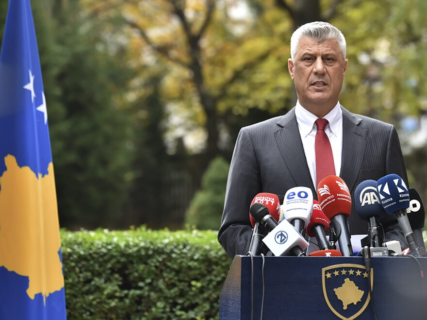 Kosovo President Hashim Thaçi announces his resignation in Kosovo capital Pristina on Thursday. He said he was stepping down to face war crimes charges in The Hague.