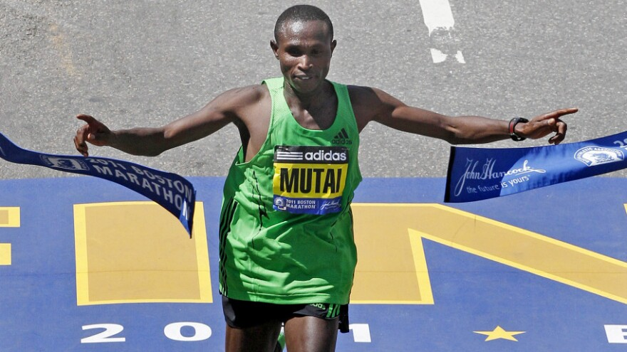 Geoffrey Mutai of Kenya breaks the tape to win the men's division at the finish line of the 115th Boston Marathon.