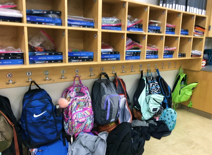 Student backpacks hanging on hooks in a classroom at Northside ISD's Mireles Elementary in  January 2019.