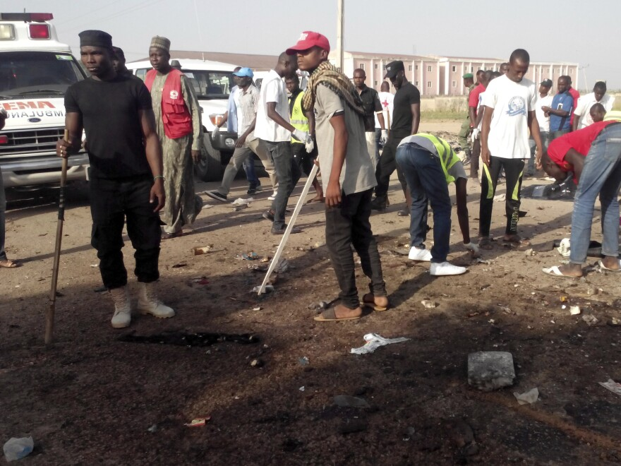 People clear the scene after an explosion in Maiduguri, Nigeria, on Saturday.