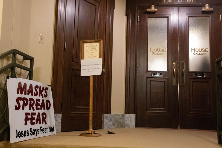 A protestor's sign sits outside the House of Representatives gallery during the swearing-in ceremony in the Capitol, January 4, 2021.