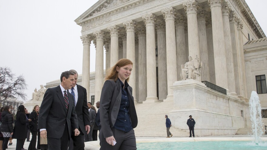 Abigail Fisher, seen outside the Supreme Court Wednesday, is a white applicant to the University of Texas who claims she was not admitted because of her race.