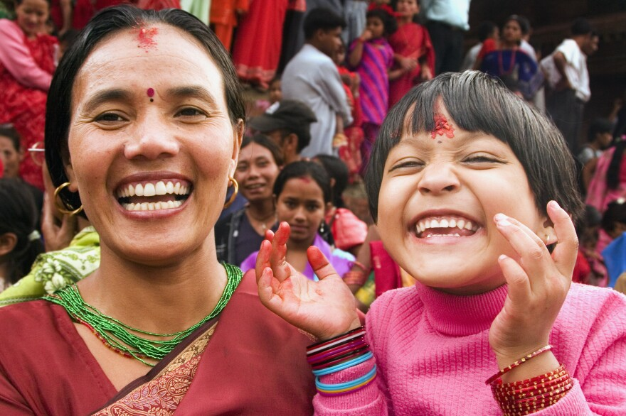 Mother and daughter at a Woman's Day festival in Durbar Square, Kathmandu. On the day of the festival, people pay homage to their mothers and perform rituals in temples or by the river.