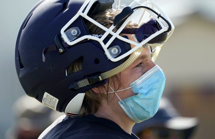 A photo of a Thrall High School football player wears a face mask as he goes through practice on Thursday, Aug. 13, 2020, in Thrall, northeast of Austin.