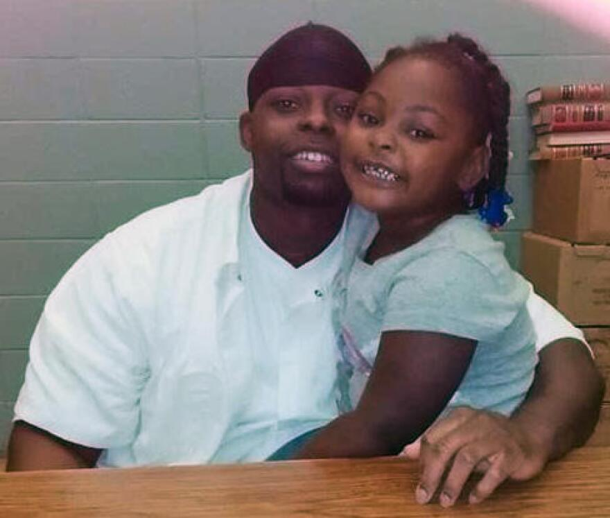 Derick Coley and his daughter during a prison visit.