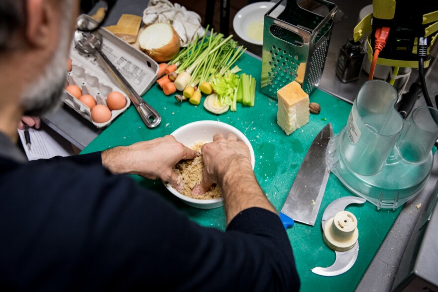 Bottura kneads the breadcrumbs with some eggs, nutmeg and grated Parmesan cheese to create a dough for our pasta.