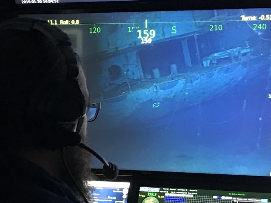 A researcher examines the underwater hull of the USS Hornet CV-8, which played a role in several key events of World War II.