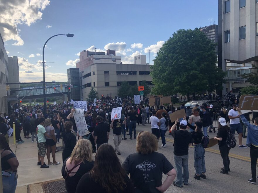 A photo of protesters in downtown Akron