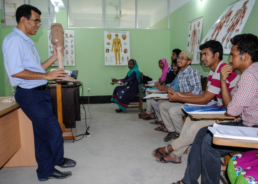 Teacher Kim Song Bo lectures at a new school that is training students to make prosthetic limbs. Classes are held at the Center for the Rehabilitation of the Paralyzed in Dhaka, Bangladesh.