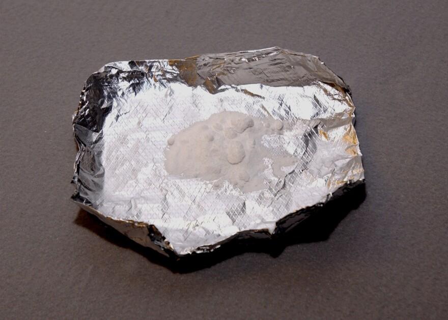 A white powder on a piece of silver foil