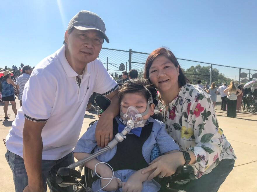 Alex Yiu with his parents, Bandy and Caroline, at Alex's middle school promotion in June.