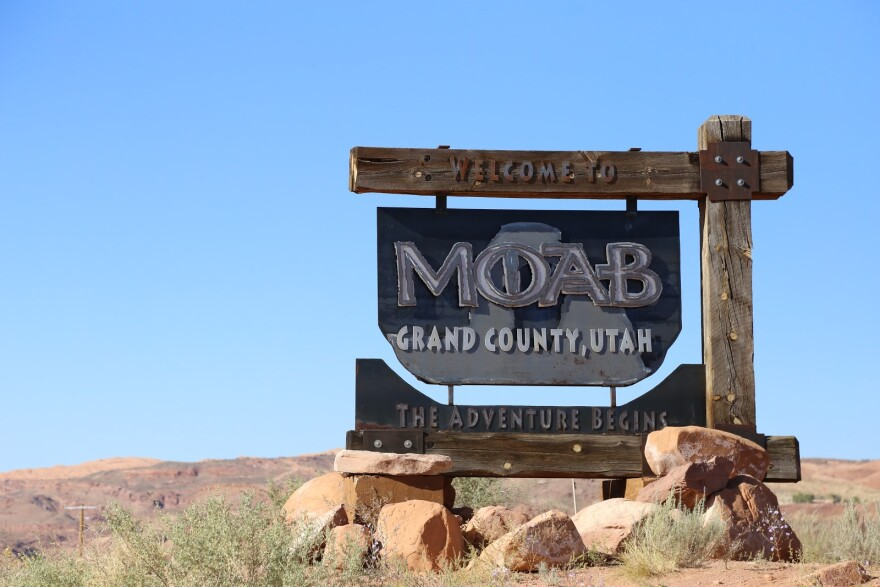 A decorative road sign welcomes visitors to Moab.