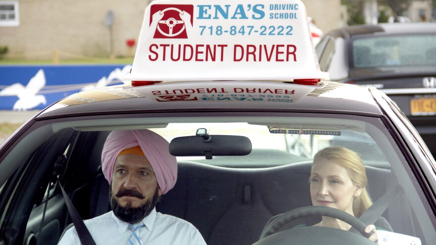 Darwan (Ben Kingsley) and Wendy (Patricia Clarkson) in <em>Learning to Drive</em>.