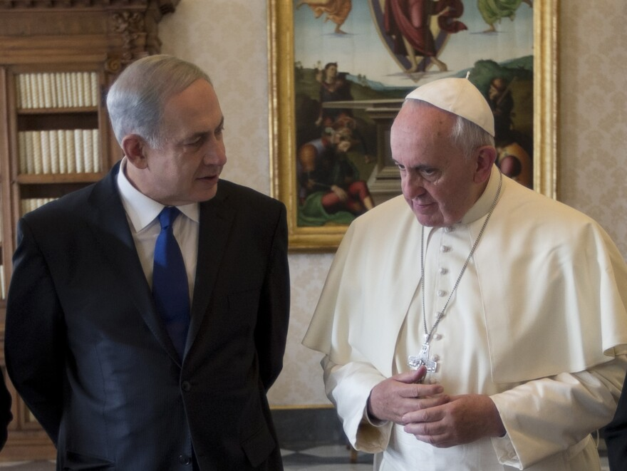 Israeli Prime Minister Benjamin Netanyahu (left) speaks with Pope Francis during a private audience at the Vatican on Dec. 2.