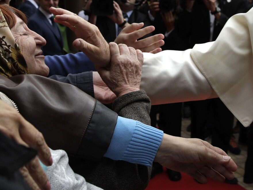 Pope Francis blesses a woman at the church of the Immaculate Conception in Baku, Azerbaijan on Sunday.