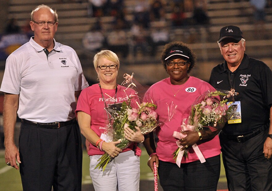 Florida Tech President and CEO Dr. Anthony J. Catanese (right) and Athletics Director Bill Jurgens (left) with a couple survivors at Panther Football's 2014 Breast Cancer Awareness Game.