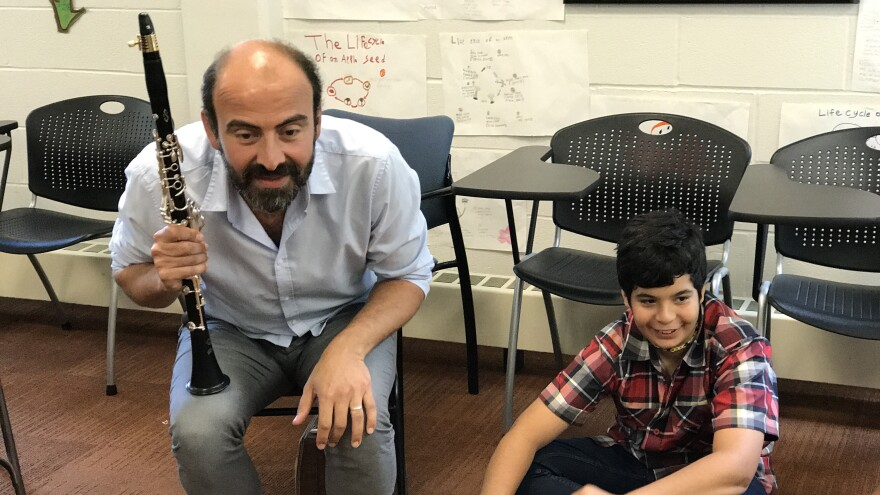Kinan Azmeh leads music workshops at the Refugee Youth Summer Academy, run by the International Rescue Committee.