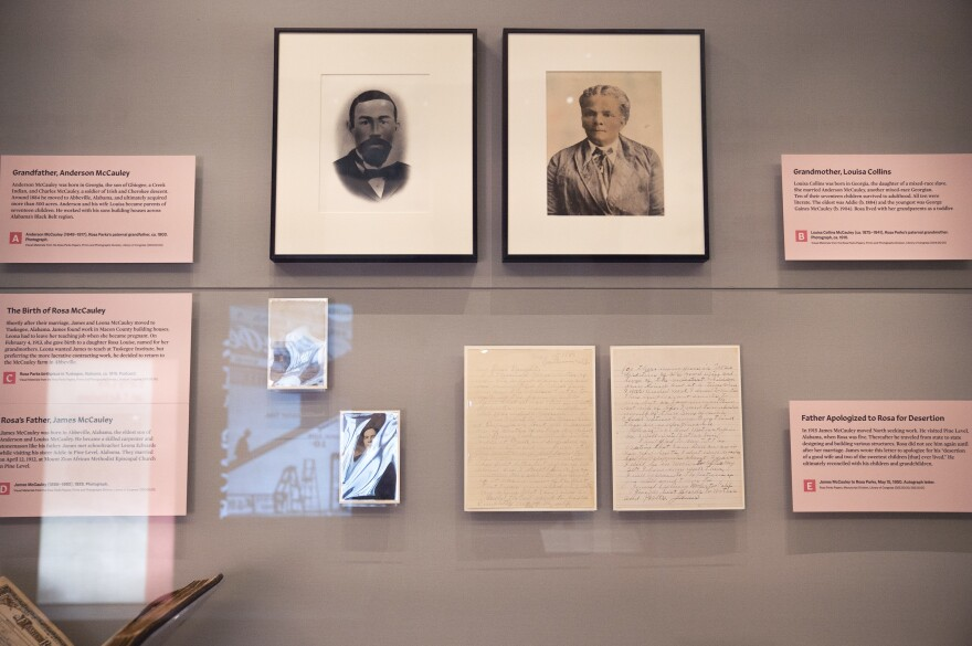 A display includes photos of Rosa Parks's family and handwritten letters about her grandparents.