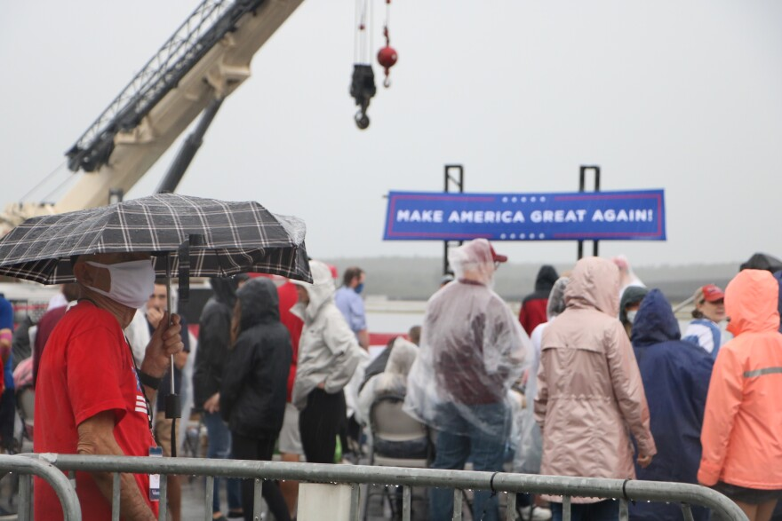 Supporters of Vice President Mike Pence and President Donald Trump waited hours in the rain to hear Pence speak Saturday, October 25, 2020.