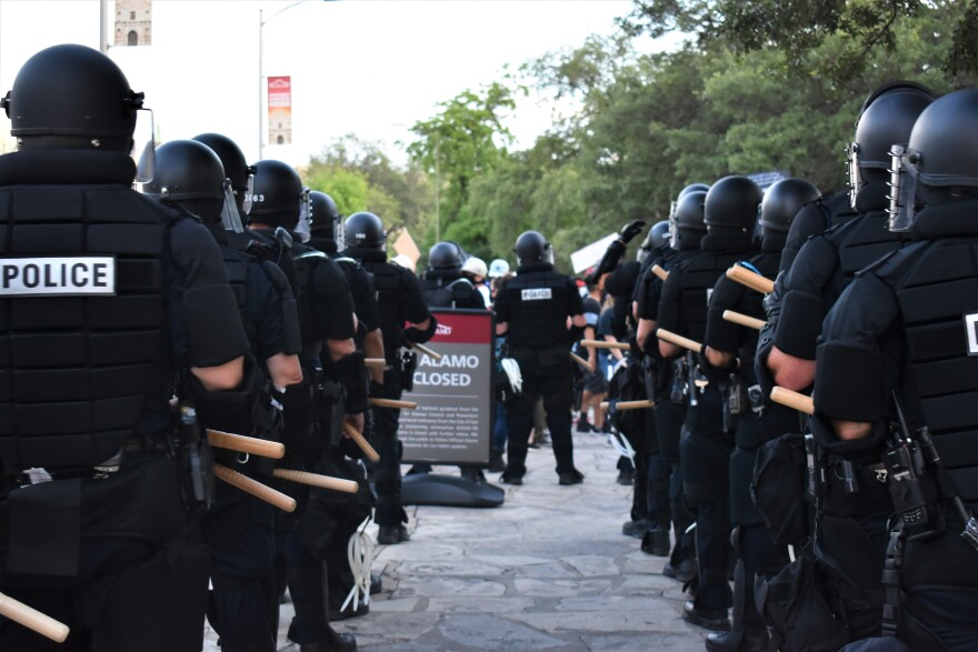 Police officers are prepped with riot gear in downtown San Antonio before a protest calling to an end for police brutality on May 30, 2020.