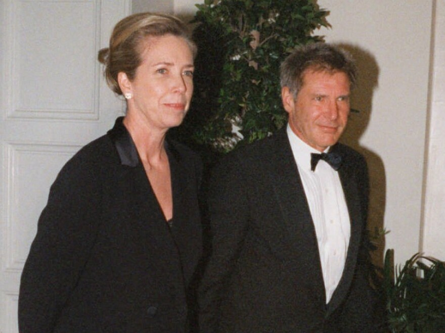 Melissa Mathison and her then-husband Harrison Ford arriving for a White House dinner in 1998.