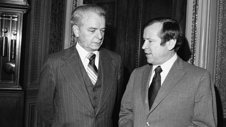 New senate majority and minority leaders, Robert Byrd, left, and Howard Baker, right, respectively, chat on Capitol Hill enroute to a joint session of Congress in January 1977.