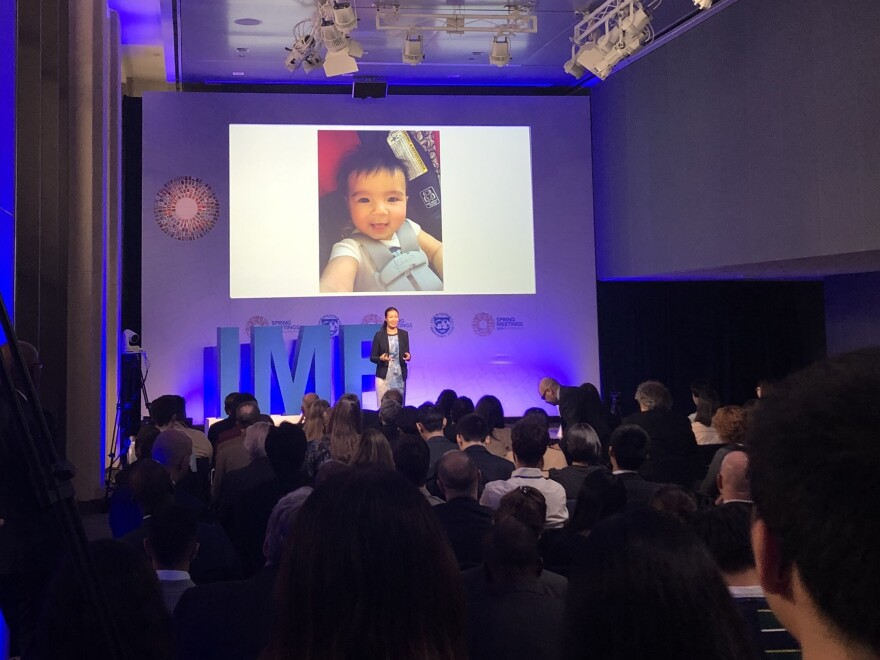 """Wenjie Chen speaks at the IMF's """"analytical corner"""" during the Spring Meetings."""