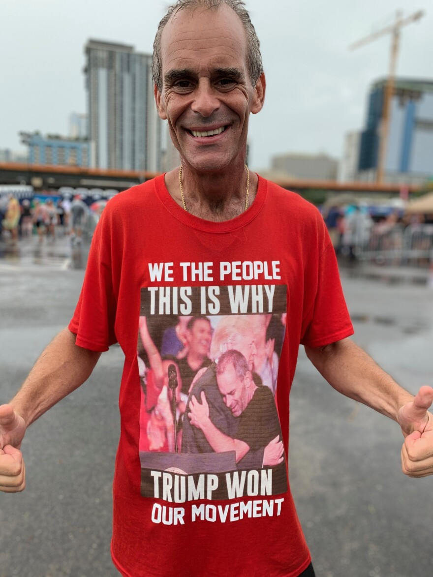 Gene Huber of West Palm Beach, Fla., was attending his 16th Trump rally and wore a shirt depicting one rally he attended where President Trump called him up on stage and gave him a hug. He says he's writing a book about Trump.