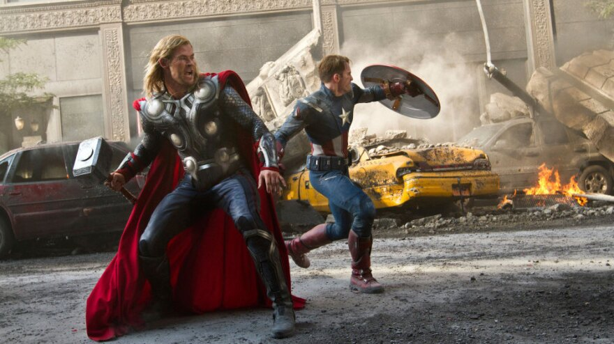 Thor (Chris Hemsworth, left) and Captain America (Chris Evans) join up with Iron Man and the Hulk to save the Earth in <em>The Avengers</em>.