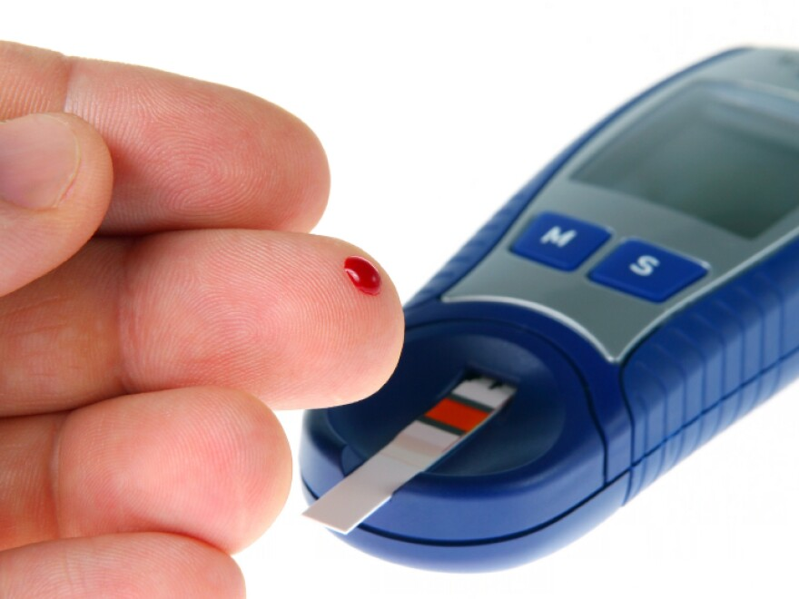 A diabetic tests his blood for glucose.