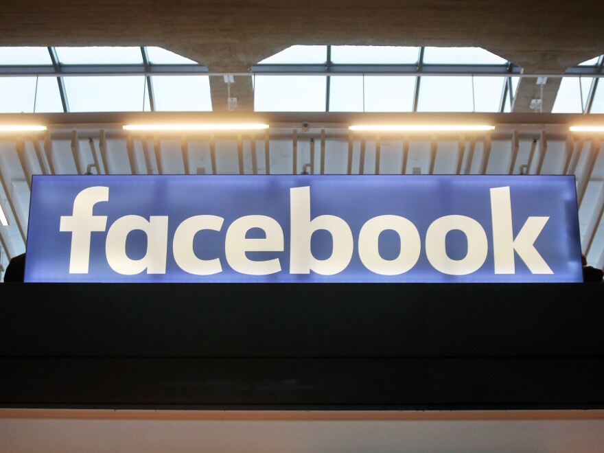 The Facebook logo is displayed at a startup gathering in Paris on Jan. 17.