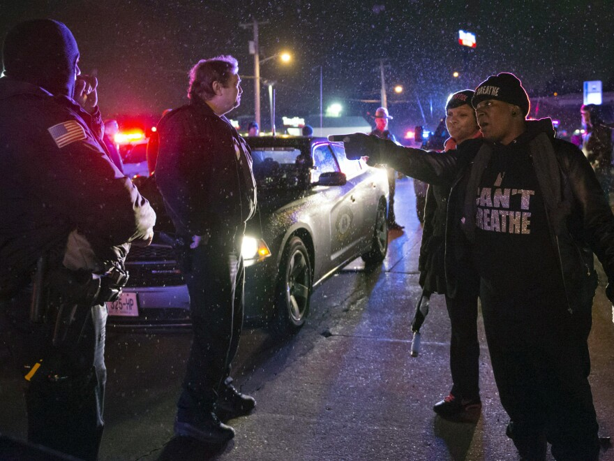 A protester shouts at police in Berkeley, Mo., Christmas Eve night.