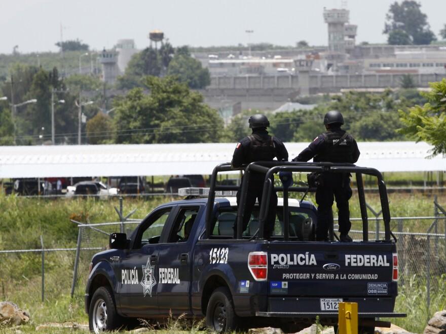 Mexican federal police patrol Friday near Puente Grande State prison (background) in Zapotlanejo, Jalisco state, Mexico, where former top Mexican cartel boss Rafael Caro Quintero was released.