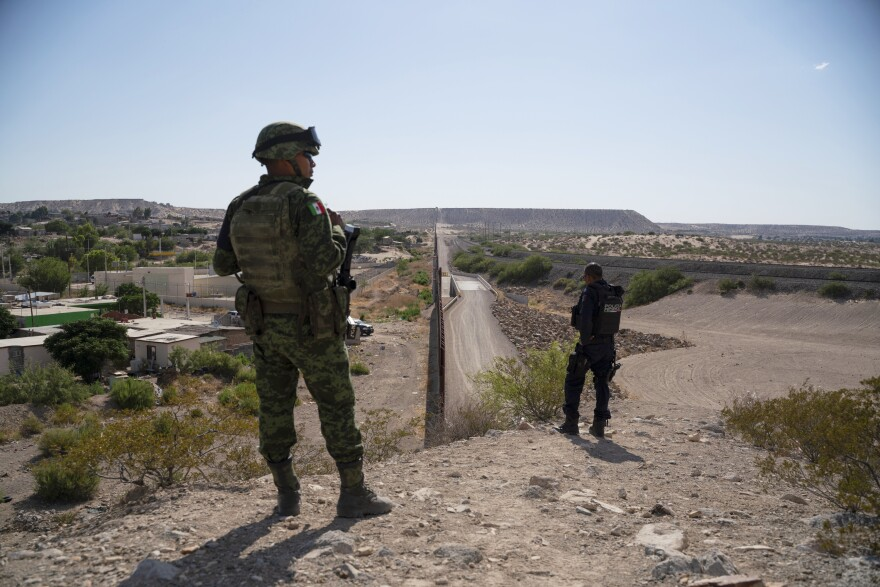 Members of Mexico's National Guard and Federal Police patrol the U.S.-Mexico border to prevent migrants from crossing into the U.S. from Ciudad Juárez. Residents and officials say they've never before seen such a deployment on the northern border.