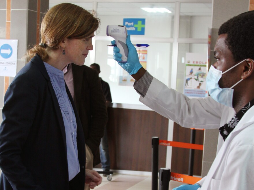 U.S. Ambassador to the United Nations Samantha Power has her temperature taken as she arrives in Freetown, Sierra Leone, on Monday. Power is on a visit to West Africa to get a first-hand look at the global response to the epidemic.