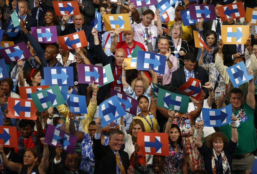 Delegates from New York hold signs in support of Hillary Clinton during the Democratic National Convention in Philadelphia on Tuesday.