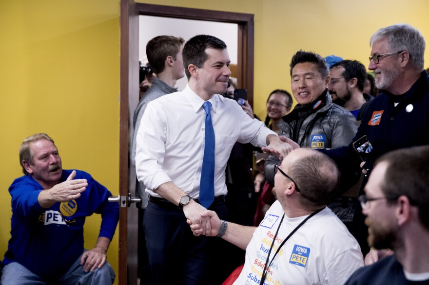 Former South Bend, Ind., Mayor Pete Buttigieg arrives to speak at a campaign office on Monday, in West Des Moines, Iowa.