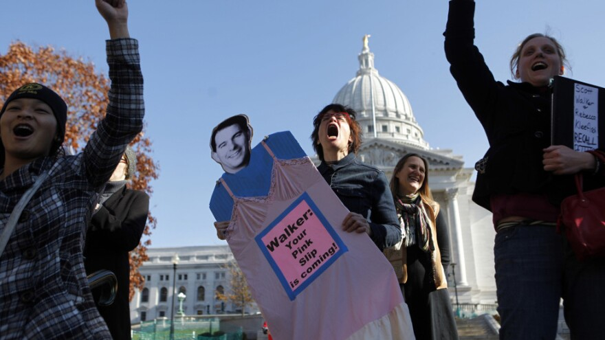 Linda Hedenblad holds a likeness of Wisconsin Gov. Scott Walker at recall rally at the State Capitol in Madison on Nov. 15.