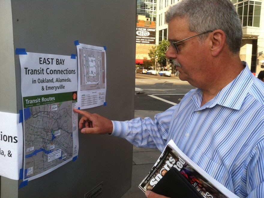IT consultant Gerard Alessi tries to figure out his way home from his office in San Francisco back to suburban Concord on Tuesday.