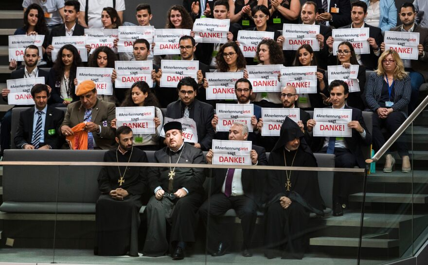 "Activists with a group that advocated for recognition of the Armenian genocide react at the German Parliament after lawmakers voted to recognize the Armenian genocide. The posters read, ""#RecognitionNow says Thanks!"""