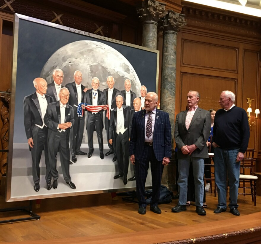 Left to right: NASA astronauts Buzz Aldrin, R. Walter Cunningham and Al Worden stand in front of Maciej Maga's painting of 10 Apollo astronauts just after it was unveiled at Old Parkland Hospital in Dallas.