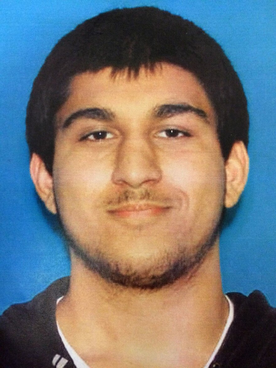 An undated Department of Licensing photo posted on Twitter Saturday by the Washington State Patrol shows Arcan Cetin, 20.