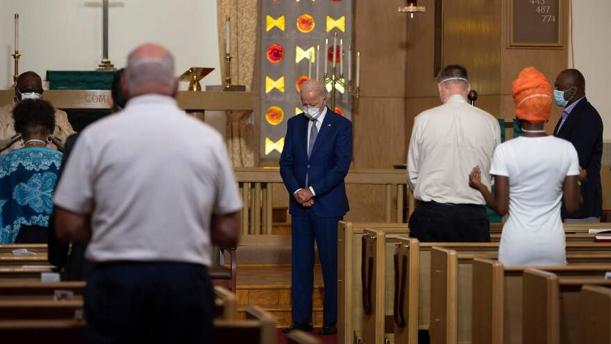 If elected, Democratic nominee Joe Biden would become only the second Catholic president in American history. Here he prays at Grace Lutheran Church in Kenosha, Wis., on Sept. 3.