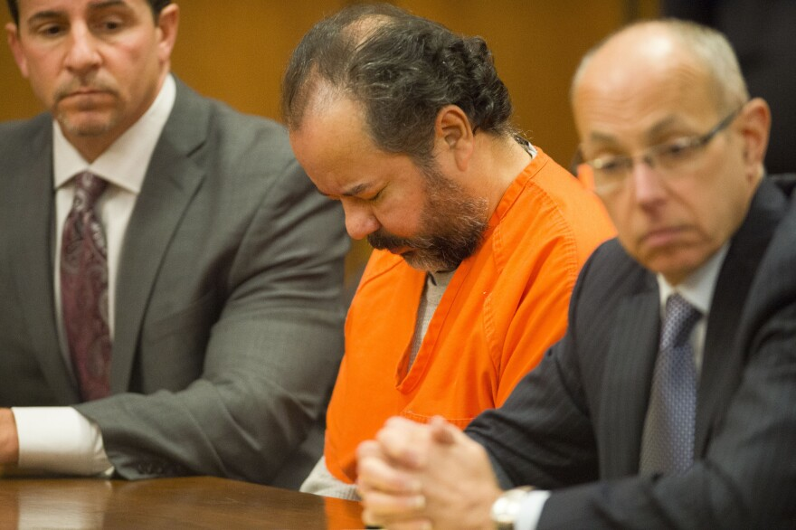 Ariel Castro sits with his defense attorneys Craig Weintraub (left) and Jaye Schlachet during Wednesday's hearing, at which he was found mentally competent to stand trial.