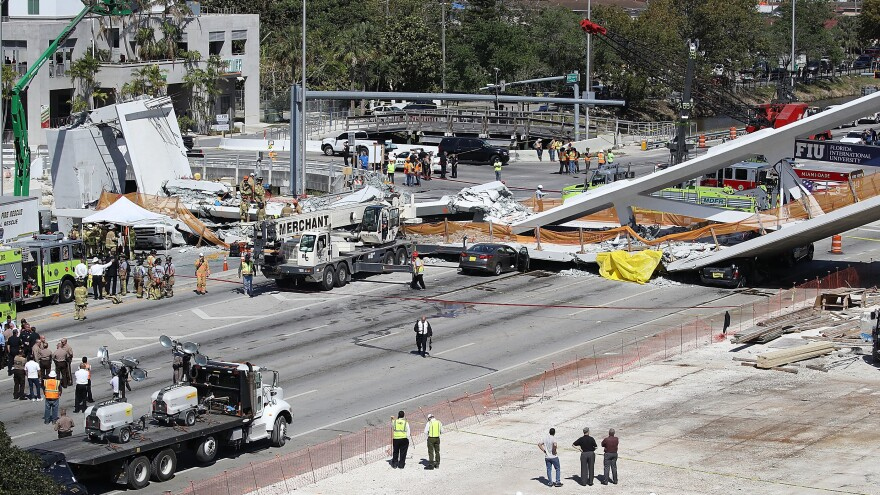 The Miami-Dade Fire Rescue Department and other personnel work at the scene where a pedestrian bridge collapsed a few days after it was built over Southwest 8th Street.